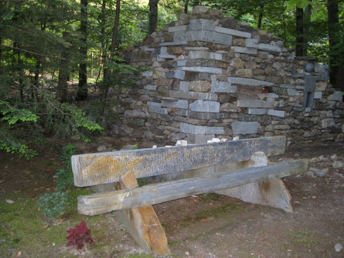 Local fieldstone and quarry stone wall built for garden accent, Goshen bench, two stones split to make a bench